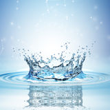Water splash in dark blue color with a drop of water flying from above. 3d rendering stock illustration