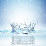 Water splash in dark blue color with a drop of water flying from above. 3d rendering Royalty Free Stock Photography