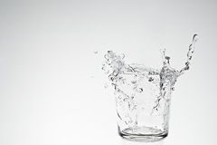Water splash in drinking glass Royalty Free Stock Photography