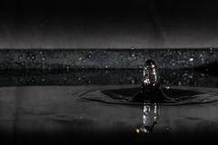 Water splash isolated on black background royalty free stock photo