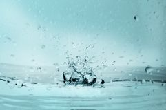 Water splash effect in blue with drops. royalty free stock image
