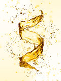 Water splash in the form of spiral gold color Stock Photos