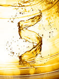 Water splash in the form of spiral gold color Stock Image