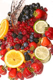 Water splash and fruits. Small display of fresh fruit Stock Image