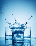 Water splash in a glass royalty free stock photography
