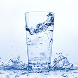 Water splash in glass Royalty Free Stock Images