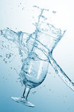 Water splash with glass Stock Image
