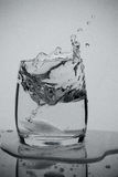 Water splash. In a glass royalty free stock photos