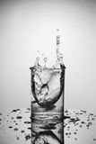 Water splash. In a glass stock photos