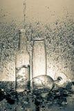 Water splash on Glass bottle Royalty Free Stock Photo