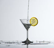 Water splash in glass. Of gray color Stock Images