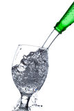 Water splash in a glass Royalty Free Stock Photos