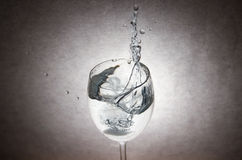 Water Splash in Glass Pot Royalty Free Stock Images