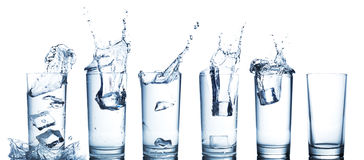 Water splash in glasses isolated on white Stock Photos