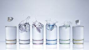 Water splash in glasses isolated on white. Background stock photography
