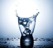 Water splash in glasses  on white Stock Photography