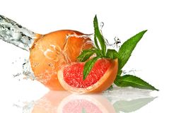 Water splash on grapefruit with mint Royalty Free Stock Image