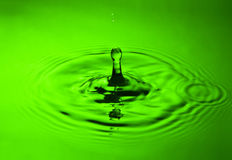 Water splash in green Royalty Free Stock Photos