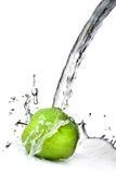 Water splash on green apple Stock Images