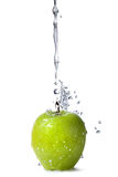 Water splash on green apple isolated on white Stock Images