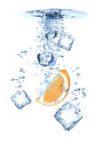 Water splash with Ice cubes and orange royalty free stock photography