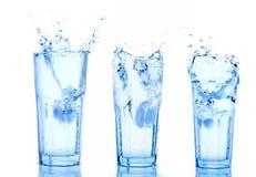 Water Splash In Glass Stock Image