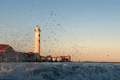 Water splash with lighthouse background Royalty Free Stock Images