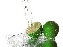 Water splash on lime Stock Image