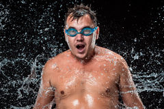 The water splash on male face Stock Image