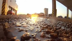 Water splash after male foot run into puddle. In slow motion 240 fps stock footage