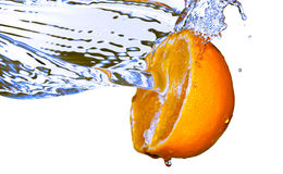 Water splash on orange. Photo of water splash on half of orange Royalty Free Stock Photography