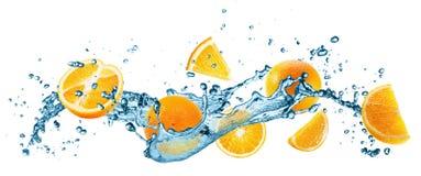 Water splash with oranges on the white background Stock Photos