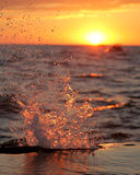 Water Splash over pier. Sunset and a water splash off the pier at Grand Haven, MI Stock Photos