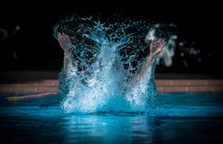 Water splash. A person in swimming pool making a water splash Stock Photography