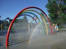 Water splash playground. A water splash playground with rainbows Royalty Free Stock Image