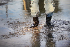 Water splash in puddle Stock Photography