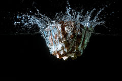 Water splash with puzzle effect. Water splash with puzzle falling in water Stock Photo