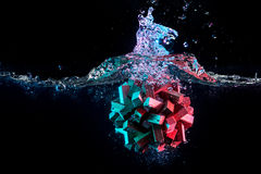 Water splash with puzzle effect. Water splash with puzzle falling in water Stock Photos