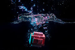 Water splash with puzzle effect. Water splash with puzzle falling in water Royalty Free Stock Image