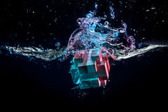 Water splash with puzzle effect Stock Images
