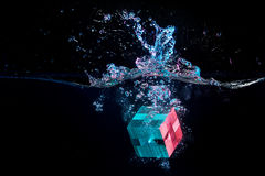 Water splash with puzzle effect. Water splash with puzzle falling in water Stock Photography