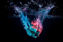 Water splash with puzzle effect. Water splash with puzzle falling in water Royalty Free Stock Photos