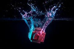 Water splash with puzzle effect. Water splash with puzzle falling in water Stock Images