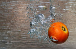 Water splash of a red tomato Stock Photo