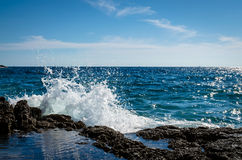Water splash on rocky seaside Stock Photography