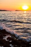 Water splash in the sea at sunset Stock Photos