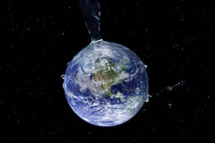 Water Splash Series - Hydrated Earth in Space. Water pouring onto the earth in space. Earth image used courtesy of NASA visible earth royalty free stock images