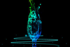 Water Splash Series - Mini Wine Glass Steady Energy Color Stock Image