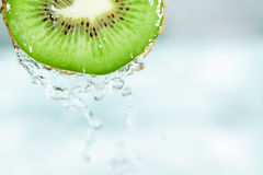 Water splash on sliced kiwi Stock Image