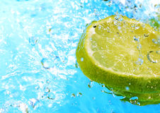Water splash on slices of lemons Royalty Free Stock Photography